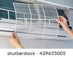Small photo of Dirty filter of air conditioner in female hands. Cleaning and washing maintenance