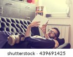 male model lying on a couch in... | Shutterstock . vector #439691425