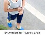 Sport Woman Use Digital Hand...