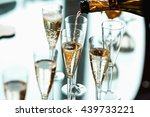Champagne Pours Into The...