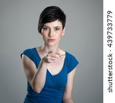 Small photo of Young short hair woman pointing finger at camera accusing or blaming you