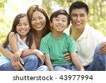 family enjoying day in park   Shutterstock . vector #43977994