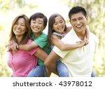 family enjoying day in park   Shutterstock . vector #43978012