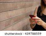 Woman Text Messaging On Mobile...