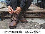 tying shoes on wooden floor ... | Shutterstock . vector #439828024