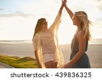 Two Young Women On The Beach...