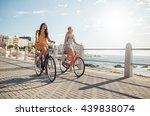 two young female friends riding ... | Shutterstock . vector #439838074