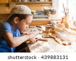Boy Learning Wood Carving....