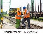 rail workers coordinating cargo ... | Shutterstock . vector #439990861