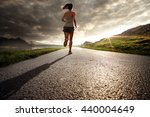 woman runner at sunset | Shutterstock . vector #440004649