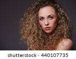 portrait of woman with curly... | Shutterstock . vector #440107735