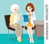 doctor talking with elderly... | Shutterstock .eps vector #440116279