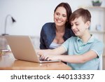 happy mother helping his son to ... | Shutterstock . vector #440133337