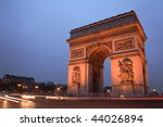 Arc de Triomphe, Paris, at night. Copy space on the left - stock photo
