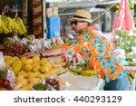 man tourist buying fruits | Shutterstock . vector #440293129