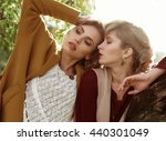 fashion women posing together... | Shutterstock . vector #440301049