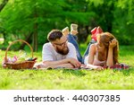 couple lying on a picnic... | Shutterstock . vector #440307385