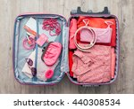 woman's open bag on a desktop... | Shutterstock . vector #440308534