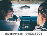 happy young couple sit in a car.... | Shutterstock . vector #440315305