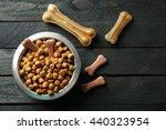 Dog Food In Metallic Bowl On...