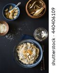 Small photo of Dried porcini risotto served with grated parmesan cheese and marinated maushrooms. Selective focus.