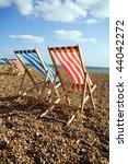 Deckchairs On Beach On Windy...