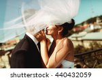 Bride And Groom Kisses Tenderl...