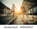 two tourists walking on the... | Shutterstock . vector #440563027