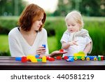 young woman with his toddler... | Shutterstock . vector #440581219