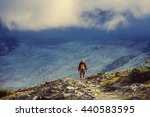 hiking man in the mountains | Shutterstock . vector #440583595