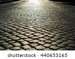 Sunlight On Cobblestone Road I...