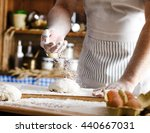 male baker prepares bread. male ... | Shutterstock . vector #440667031