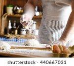 male baker prepares bread. male ... | Shutterstock . vector #440667031