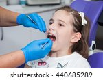 girl at a dentist examination | Shutterstock . vector #440685289