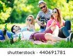 group of friends having picnic... | Shutterstock . vector #440691781