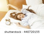 young asian woman in bed trying ... | Shutterstock . vector #440720155