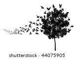 Vector silhouettes of a pigeon flock flying to a tree roost - stock vector