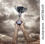 silver cup in dirty hands on... | Shutterstock . vector #440788105