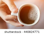 white cup of coffee in hand.... | Shutterstock . vector #440824771