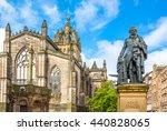 Small photo of Edinburgh, Scotland - JULY 28, 2012: The Royal Mile, the apse of the St Giles Cathedral and the monument to Adam Smith.