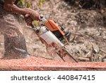 a thai worker cutting trunk... | Shutterstock . vector #440847415