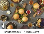 different burgers with snacks