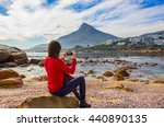 a tourist takes a photo on her... | Shutterstock . vector #440890135