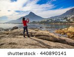 a female tourist takes a photo... | Shutterstock . vector #440890141