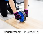 Small photo of abs training roller,ab wheel in fitness gym.