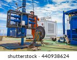 Offshore oil and gas industry, worker inspect and setting up top side tools for safety first to perforation oil and gas production well. Hard work oil and gas occupational. - stock photo