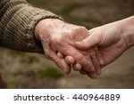 old and young person holding... | Shutterstock . vector #440964889