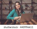 smilling woman with headphones... | Shutterstock . vector #440996611