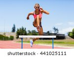 female athlete jumping above... | Shutterstock . vector #441025111