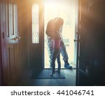 A soldier dad is coming home in the door and hugging his child for a love, family or reunited concept. - stock photo